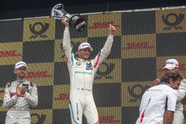 Marco Wittmann wins race five of the DTM season from last place on the grid.
