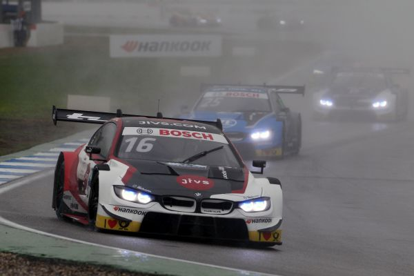 Turbulent, rain-soaked race to finish the DTM season: Glock best-placed BMW driver in fourth.