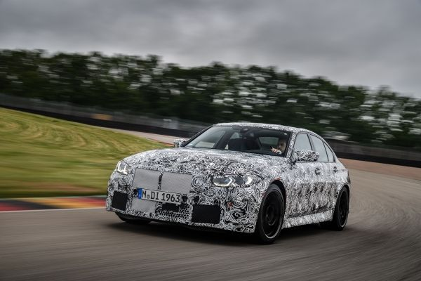 The new BMW M3 Sedan and the new BMW M4 Coupé on the racetrack
